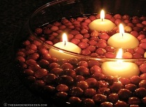 candles-floating-in-a-bowl-of-cranberries-ⓒ-Michaela-at-TGE