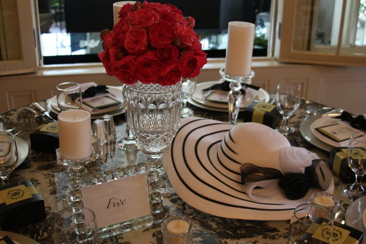 kentucky derby wedding roses and hat table centerpiece
